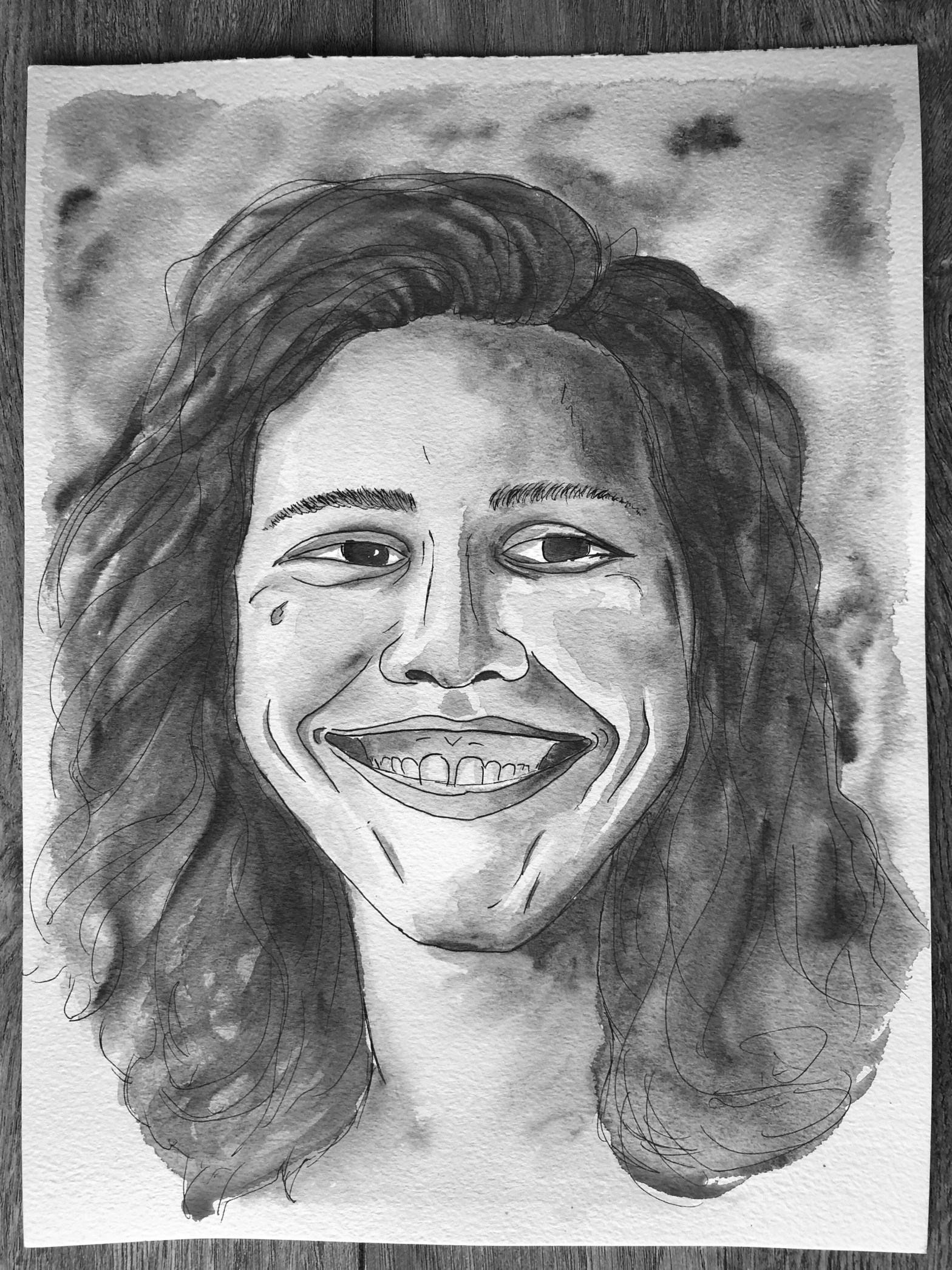 Black and white watercolor portrait of a woman smiling.